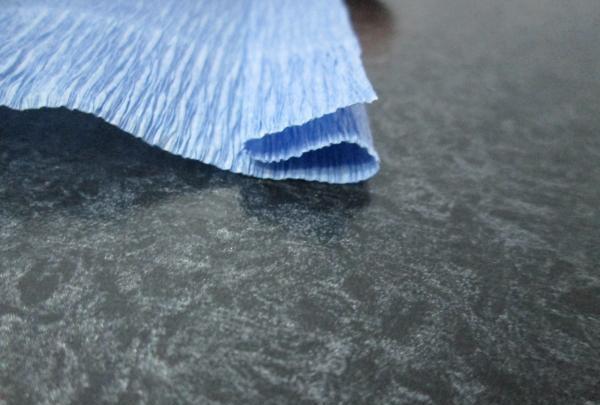Tăiați hârtia ondulată