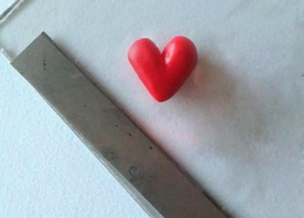 Dați triunghiului o formă de inimă