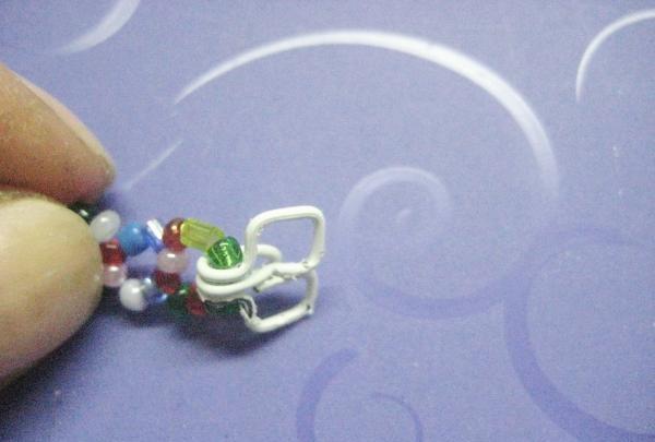 fastgjort til perler