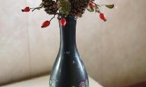 Vase from a bottle with autumn ikebana