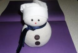 Snowman made from sock and rice