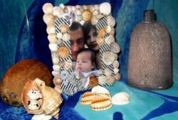 Kumaş ve deniz kabuğu fotoğraf çerçevesi