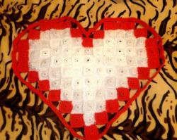 Knitted rug in the shape of a heart