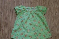 We sew a summer blouse for the baby with our own hands