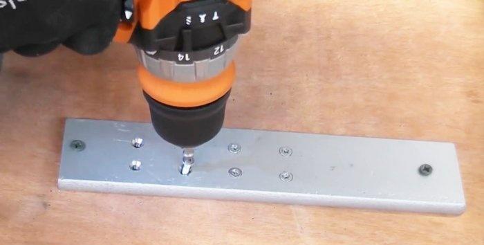 Πώς να ξεβιδώσετε μια βίδα με επικάλυψη χρησιμοποιώντας ένα εξολκέα