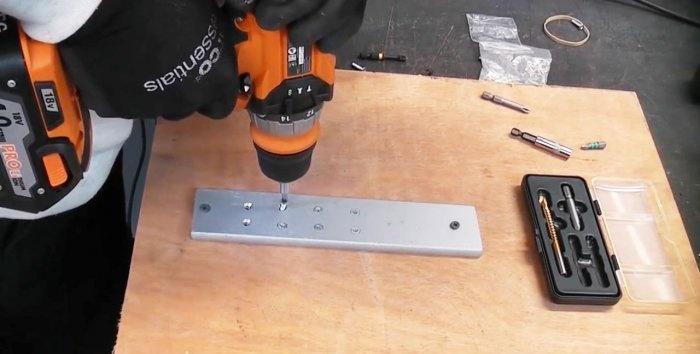 Πώς να ξεβιδώσετε μια βίδα με επικάλυψη χρησιμοποιώντας ένα ειδικό κομμάτι