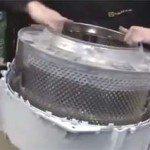 Membongkar tangki mesin basuh