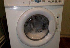 как да отворите машината по време на миене
