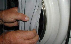 Hogyan lehet eltávolítani a mosógép nyílásának mandzsettáját