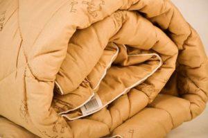 по-добре е да измиете одеялото от камилска вълна на ръка