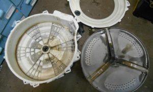 פירוק המיכל הבלתי ניתן להפרדה של מכונת הכביסה